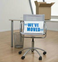 a chair and moving boxes